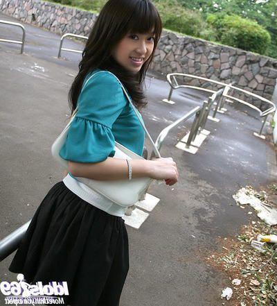Frisky asian babe revealing her nice gut alongside changeless nipples