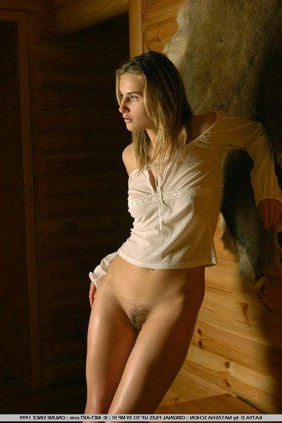 Teenage neighbourhood pub woman Katya D with pierced umbilicus and hairy pussy poses nude