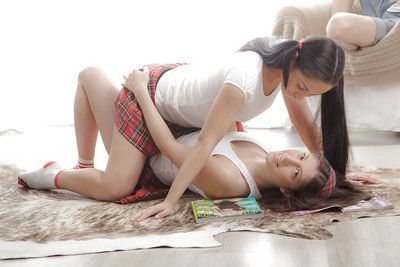 Young butch schoolgirls Betty and Fantina undress for pussy licking