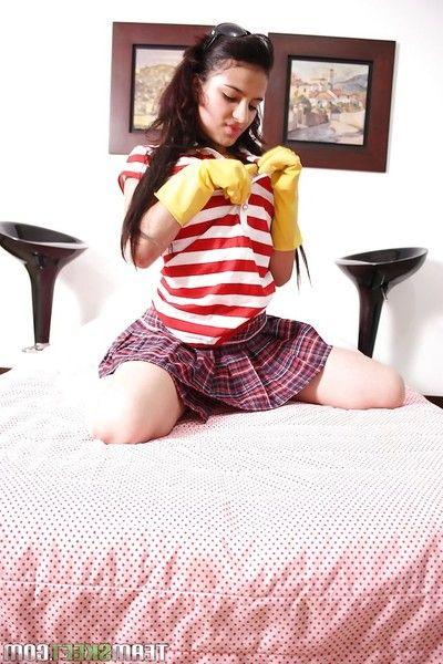 Dark haired Latina babe Tanya Vivas undressing her instructor skirt