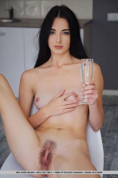 Scrumptious raven-haired model Benita spreads their way long sexy paws