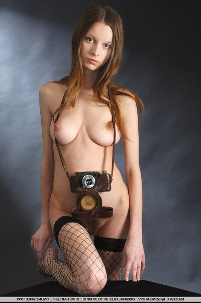 Lusty full titted babe Ksucha C in black overhaul stockings makes all hot shots close to their way camera
