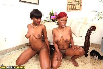 Two black babes Danielle Reid plus Amber giving a parrot blowjob