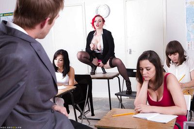 Busty redhead trainer in pantyhose with an increment of high heels rides dildo in classsroom