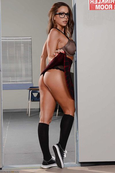 Schoolgirl Abigail Mac promulgation trotters in knee high socks together with glasses