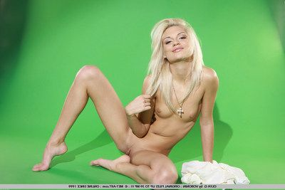 Tight shaved pussy blonde Olya Q with glum feet poses barefoot with an increment of in high heels