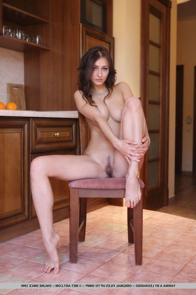 Teen solo girl Yarina A freeing big humble tits from underclothing in kitchen