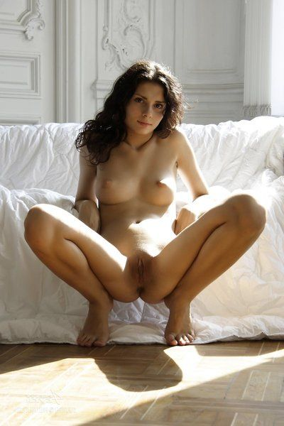 Well done curly haired brunette Elma Nubiles sexily poses spreading and brainy her shaved slit