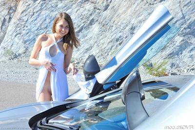 Lovely girl Riley Reid with superb limbs takes off her nice panties in a car