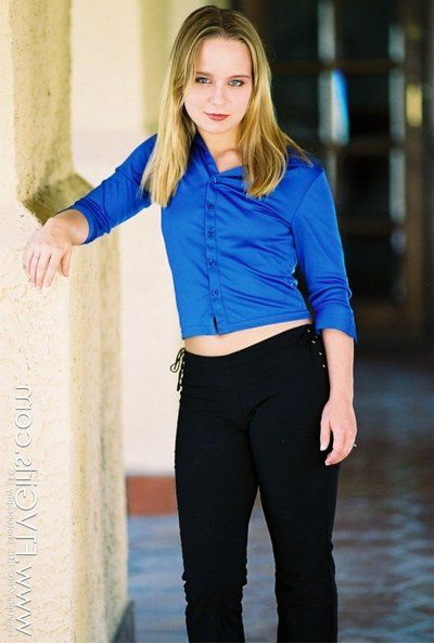 Cute miss Lillian Lee unbuttons her blue blouse and displays her titties