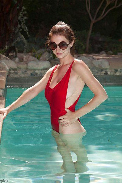 Big tit redhead amateur Essie Halladay having fun in a swimming pool
