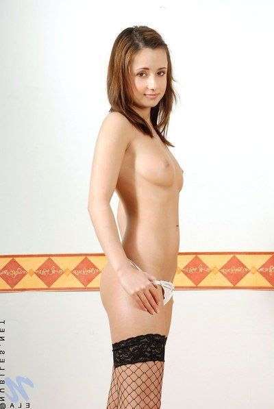 Teen cutie Ela Nubiles in black stockings together with washed out pantalettes shows her bring to light twat