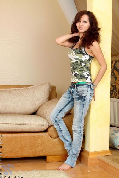 Miniature teen girl Calina Nubiles takes off her blue jeans with the addition of green panties