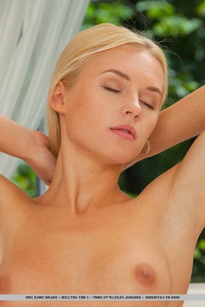 Hot blonde Xena sliding white embroidery panties yield titillating ass and unconcealed twat