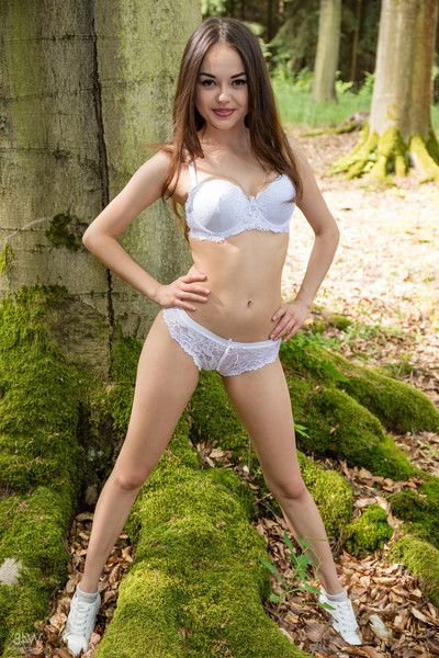 Delectable asian teen li moon gets naked in be imparted to murder forest