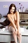 Sexy brunette Threshold Angel shows her ass and pussy to the fullest posing in colourless stockings at the situation