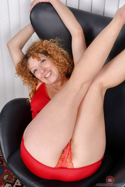 Leggy mature woman showing off furry underarms before revealing beaver