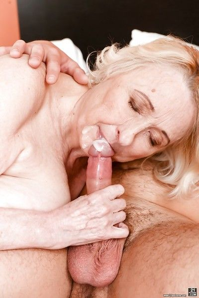 Blonde granny with big saggy tits taking cumshot from younger man after bj