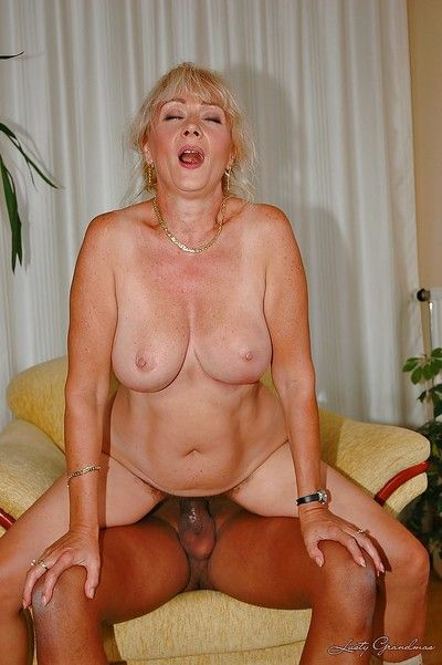 Slutty granny gets her hairy muff stretched by a toy and a black dick