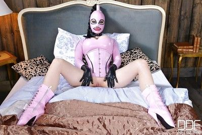 Latex adorned fetish model Latex Lucy posing in granny boots and corset