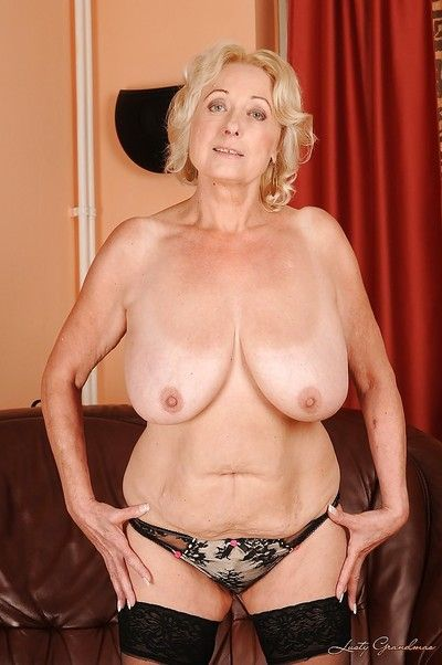Blonde granny in stockings slipping off her dress and lingerie
