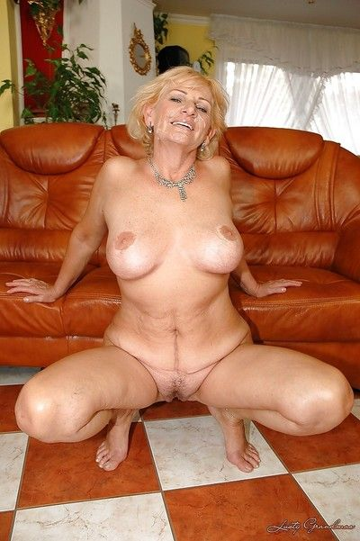 Big busted granny gets her twat stuffed with a toy and a big black cock