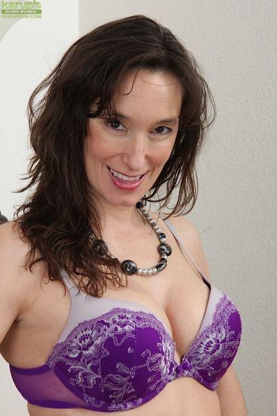 Undressing and masturbating mature brunette Shelly Jones in close up