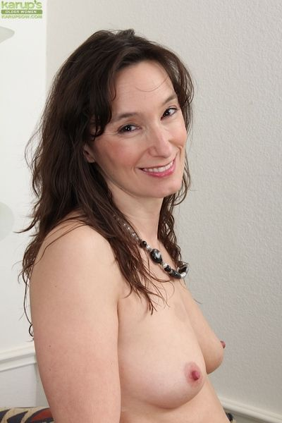 Undressing and masturbating mature brunette Shelly Jones in close up