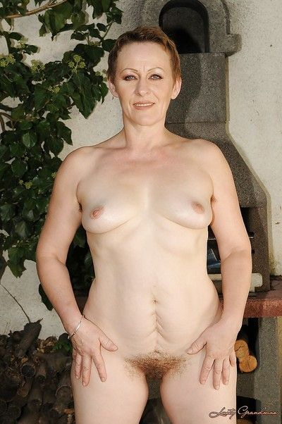 Lusty mature lady with small tits stripping and posing naked outdoor