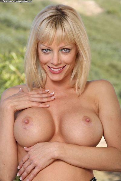Slim blonde milf Holly Sampson with incredibly sexy huge melons and clean pussy shows it all
