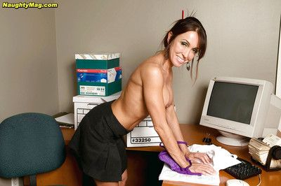 Sexy mature secretary Christina Cross showing big tits and hot ass at office