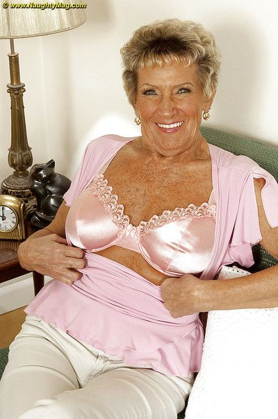 Busty granny Sandra Ann stripping off her lingerie and poses naked