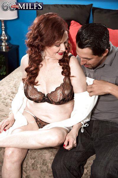 European redheaded granny Katherine Merlot giving blowjob in lingerie