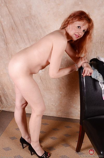 High heel wearing older redheaded woman sliding panties over great legs