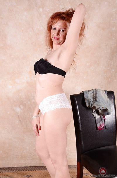 High heel wearing older redheaded woman sliding panties over great legs
