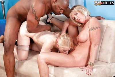 Busty grannies pleasuring huge black cock in interracial threesome