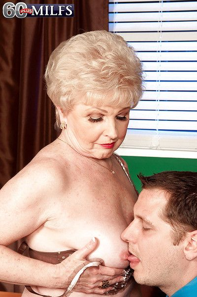 Bossy granny in nylon stockings gets her old pussy licked on the office desk