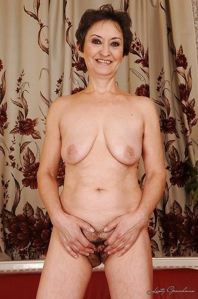 Lustful granny taking off her dress and exposing her hairy twat