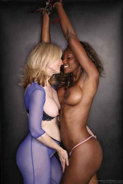 Interracial lesbian action with hot MILF Nina Hartley and Nyomi Banxxx is a must see.