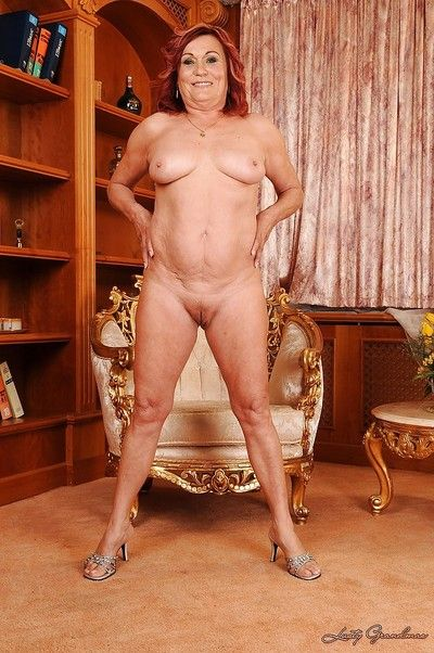 Curvaceous granny on high heels stripping off her clothes