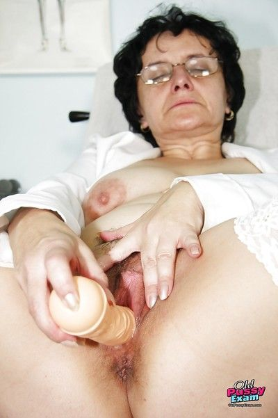 Naughty granny in glasses masturbating her twat with a dildo