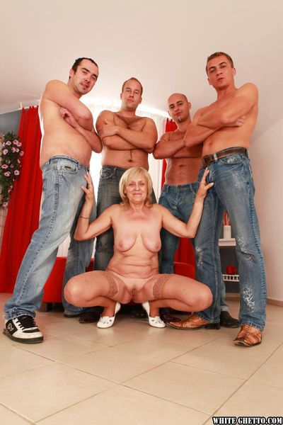 Stocking clad granny Adriana G gangbanged and covered in cum by younger men