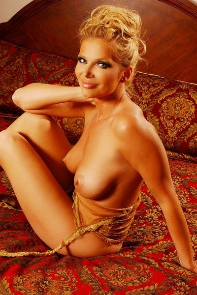 Beautiful blonde milf Victoria Zdrok shows off her big boobs and neat european pussy