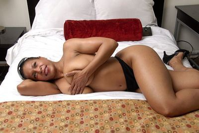Ebony mom Semmie Desuora revealing shapely tits and posing in panties and shades