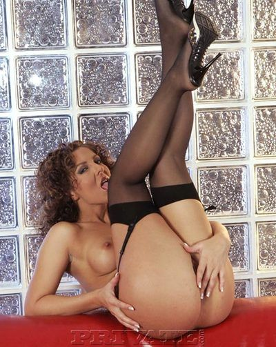 Curly haired heartbreaker Maria Bellucci with perfect round tits poses in black stockings