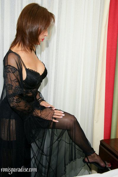 Mature seductress Roni flashing her tits in sexy see-thru lingerie