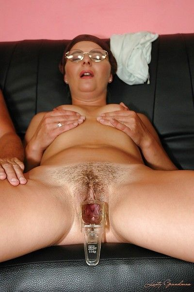 Naughty granny in glasses gets gangbanged by two horny guys