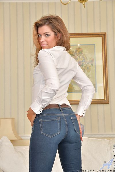 Mature lady Vanessa Jordan poses fully clothed in jeans and high heels