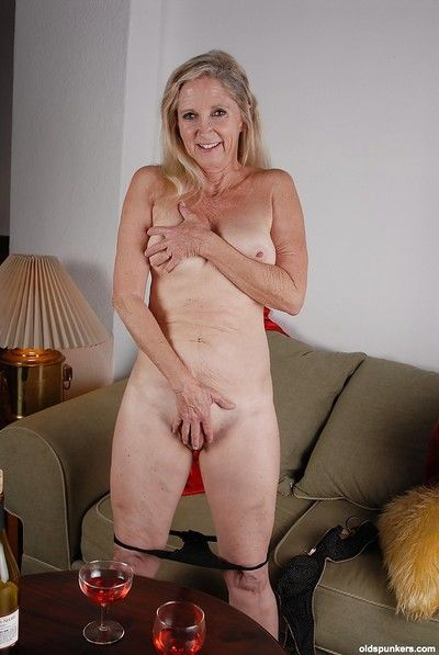 Old woman Annabelle is posing naked and playing with her ass