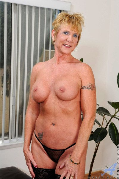 Stocking and lingerie clad gran Honey Ray baring big tits and masturbating